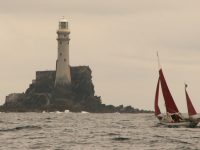 Jack O'Keeffe leads a race of Drascombes around the Fastnet Rock | Photo: David McWhiter